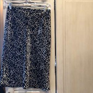 Fun giraffe print black skirt